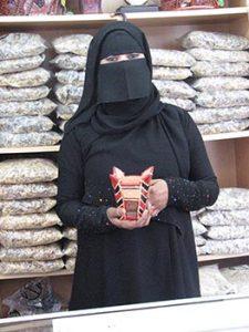 Omani woman in shop