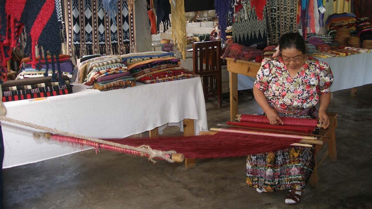 woman weaving at cooperative
