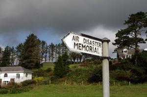sign pointing toward Air India Disaster memorial