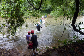 wading through a river