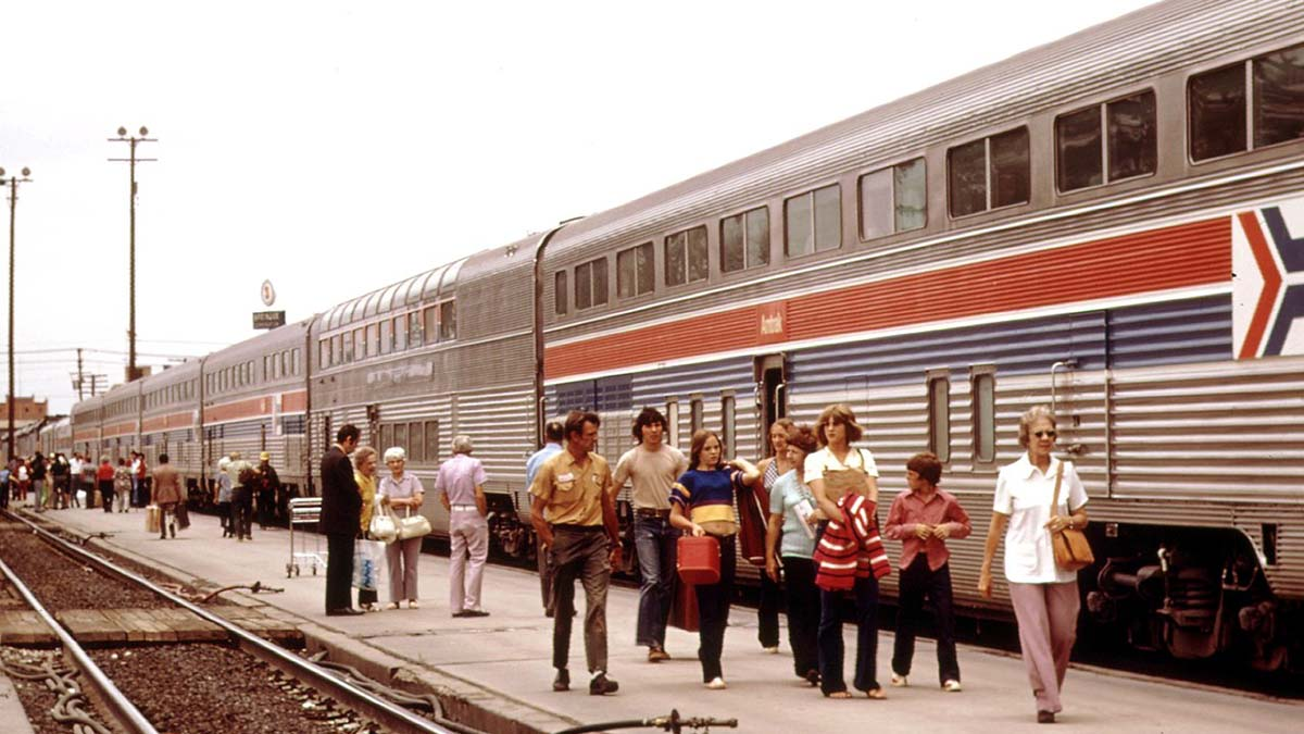 Amtrack train and passengers in station