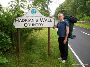 the author, Marc Latham, at Hadrian's Wall Country sign