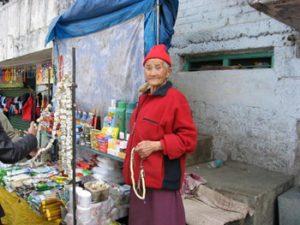 Tibetan woman selling jewelry
