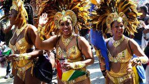 women dancing in Notting Hill Carnival