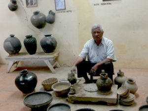 Oaxaca potter and his vases
