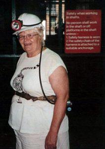 The author, Ruth Kozak, wearing coal mining gear