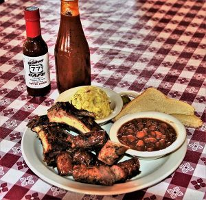 platte of barbecue ribs and beans