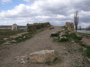 stones in road in front of old bridge