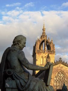 statue of David Hume with St. Giles' cathedral behind