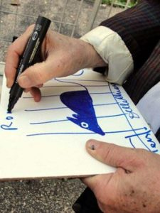 Fausto autographing a drawing