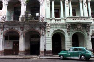 vintage car and historic building in Havana Cuba