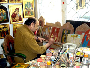 Dimitris Zazanis painting a Greek icon