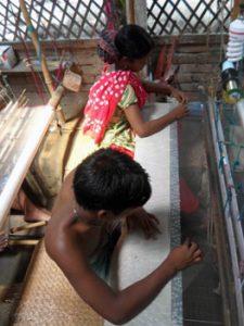 workers making a Jamdani sari
