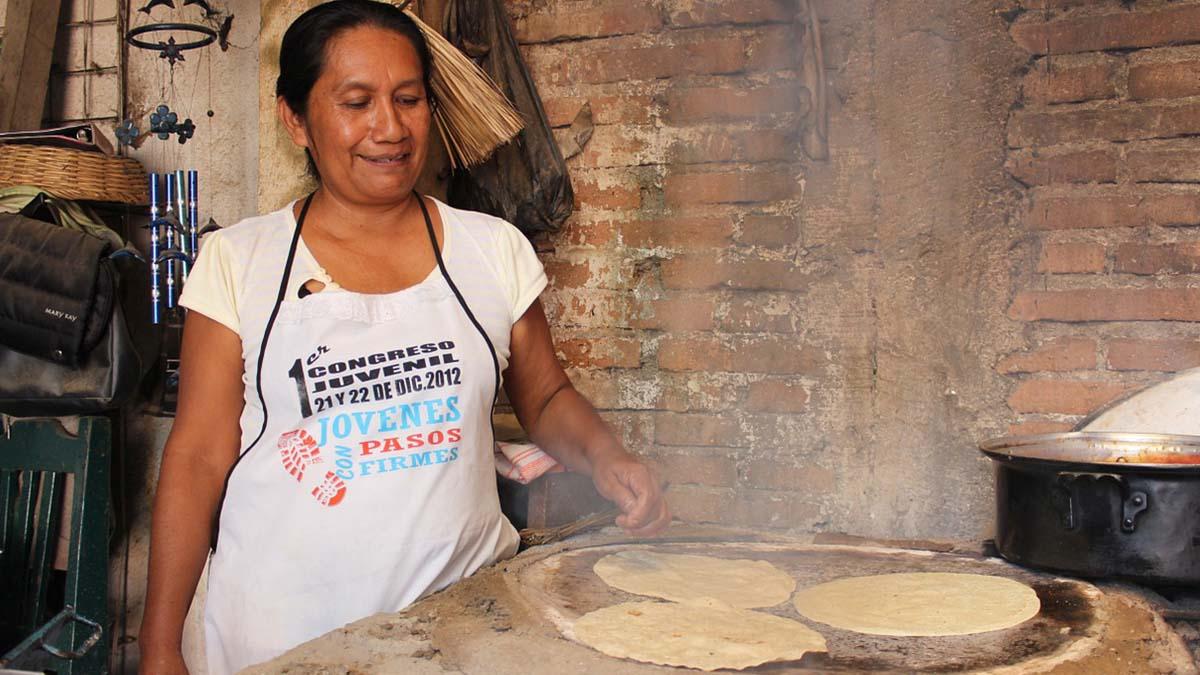 Oaxaco woman making tortillas