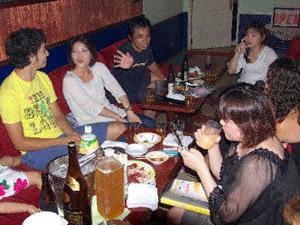 Okinawa New Year celebrants at tables