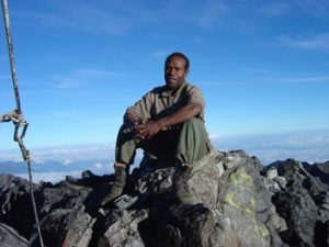 guide at top of Mt. Wilheim in PNG