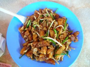 plate of stir-fried chicken with vegetables