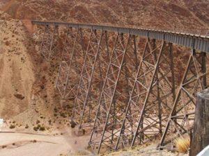 railway trestle crosses high over desert canyon