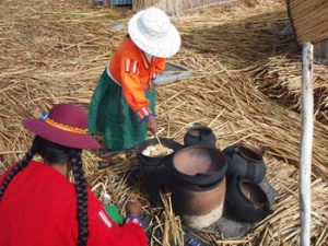 Uros woman frying bread