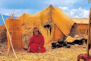Uros woman sitting among reeds