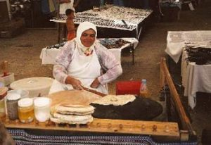 cooking flatbread in Turkish cafe